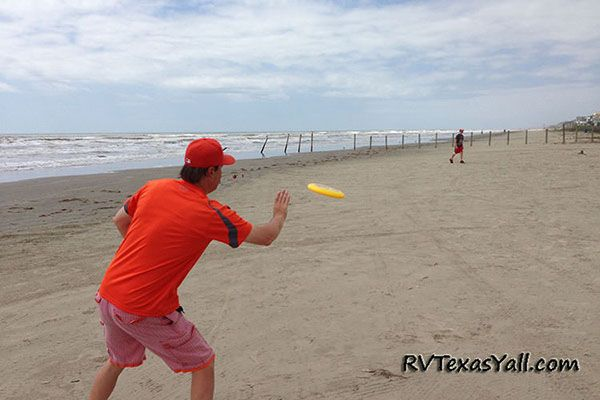 Playing Frisbee on the Beach